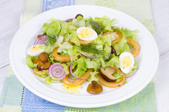 Fresh salad with mushrooms, squid and quail eggs Stock Photos