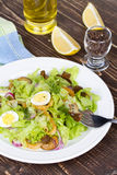 Fresh salad with mushrooms, squid and quail eggs Royalty Free Stock Photo