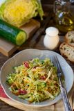 Fresh salad of napa cabbage with carrots, cucumber and salami. Fresh vegetable salad of napa cabbage with carrots, cucumber and salami stock images