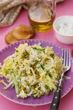 Fresh salad of napa cabbage with cucumbers and peas. Fresh vegetable salad of napa cabbage with cucumbers and peas stock photo