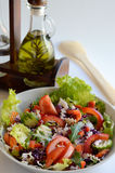 Fresh salad with oil bottle Stock Image