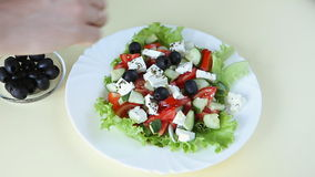 Fresh salad with olive oil stock video