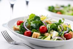 Fresh salad with olives, prawns, lemons and sauce Royalty Free Stock Photo