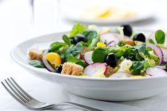 Fresh salad with olives, prawns, lemons and sauce Royalty Free Stock Photography