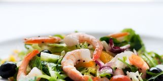 Fresh salad with olives, prawns, lemons and sauce Royalty Free Stock Photos