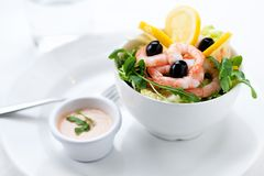 Fresh salad with olives, prawns, lemons and sauce Stock Photography