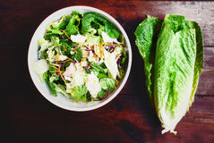 Fresh salad over wood desk close up Royalty Free Stock Images