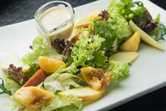 Fresh salad with pears and leaf Royalty Free Stock Photo