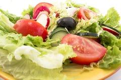Fresh salad on a plate.  Stock Photos