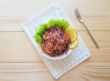 Fresh salad plate with mixed roots celery, carrot, red cabbage on light wooden background close up. Healthy food. Green meal. Fresh salad plate with mixed roots Royalty Free Stock Images