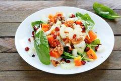 Fresh salad with pumpkin and celery. Food closeup Stock Photos