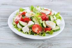 Fresh salad with quail eggs Royalty Free Stock Image