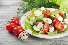 Fresh salad with quail eggs Royalty Free Stock Photography