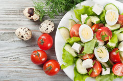 Fresh salad with quail eggs and tomato Stock Photography