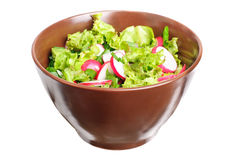 Fresh salad with radishes, lettuce and onions. On bowl isolated on white Stock Photo