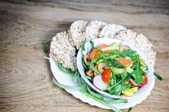 Fresh salad and rice galettes - closeup Royalty Free Stock Photos