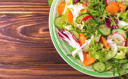 Fresh salad with salad mix, cucumber, radish and carrot Royalty Free Stock Images