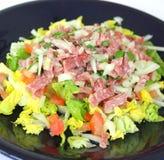 Fresh salad with salami Stock Photography