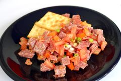 Fresh salad of salami and tomatoes Stock Images