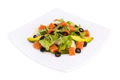 Fresh salad with salmon. On a white background Stock Photo