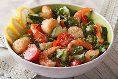 Fresh salad with seafood and vegetables in a bowl closeup. Royalty Free Stock Images