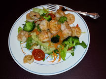Fresh Salad with Shrimp. A serving of fresh salad topped with shrimp is great for a low carb diet Stock Photo