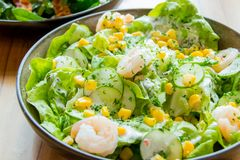 Fresh salad. With shrimps and corn kernels Royalty Free Stock Photos