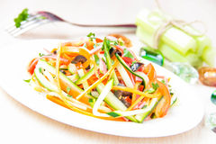 Fresh salad of sliced thin strips of carrot and zucchini as snac Royalty Free Stock Images