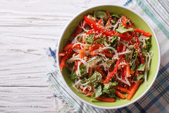 Fresh salad with sprouts, peppers and sesame seeds. horizontal t. Fresh salad with sprouts, peppers and sesame seeds close up in a bowl. horizontal view from Stock Image