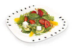 Fresh salad with strawberries, arugula, pine nuts, cream cheese, mango and avocado stock images