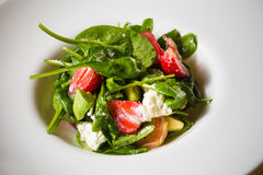 Fresh Salad with strawberries, goat cheese and Royalty Free Stock Photography