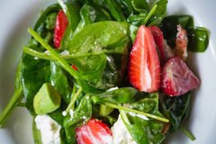 Fresh Salad with strawberries, goat cheese and Stock Photos