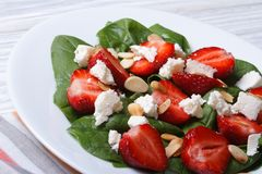 Fresh salad of strawberries, spinach, goat cheese and almond Stock Photo