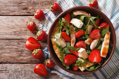 Fresh salad with strawberry, chicken, brie and arugula. horizont Stock Photography