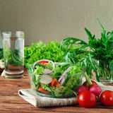 Fresh salad of summer vegetables in a deep bowl of glass Stock Image