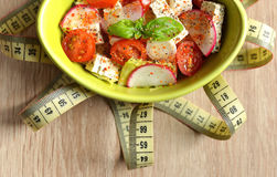 Fresh salad with tofu in bowl and measuring tape. Stock Photography