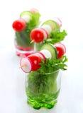 Fresh salad with tomato, cucumber and radish Stock Photos