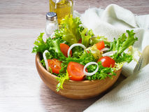 Fresh salad with tomato, frisee and onion Royalty Free Stock Photo