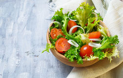 Fresh salad with tomato, frisee and onion Stock Photos
