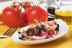 Fresh salad with tomato and olives Royalty Free Stock Image
