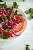 Fresh salad with tomato, onion and basil. Perfect healthy lunch idea: Fresh salad with tomato, onion and basil Stock Image