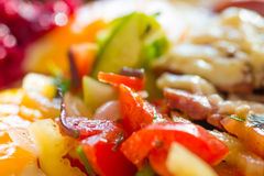Fresh salad with tomato. And fresh vegetable close up Royalty Free Stock Photo