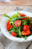 Fresh salad with tomatoes and arugula Stock Photo