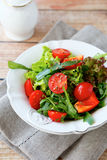 Fresh salad with tomatoes and arugula on a plate Royalty Free Stock Photography