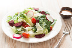 Fresh salad with tomatoes. Beetroot and radish on wood table royalty free stock photos