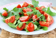 Fresh salad with tomatoes cherry, arugula Stock Photos