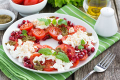 Fresh salad with tomatoes, cottage cheese, mint pesto Royalty Free Stock Image
