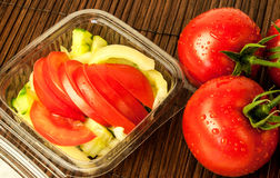 Fresh salad with tomatoes, cucumber and green pepper. In a casserole Royalty Free Stock Photo