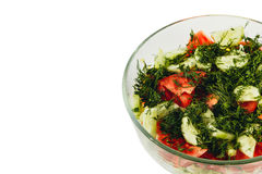 Fresh salad with tomatoes, cucumbers, dill in a bowl on white background Stock Photos