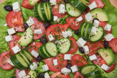 Fresh salad with tomatoes, cucumbers, feta and olives Stock Photos